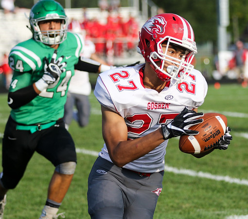 CHAD WEAVER | THE GOSHEN NEWS<br /> Goshen wide receiver Brandon Holley turns up field after making a catch during the first quarter of Friday night's game at Concord.