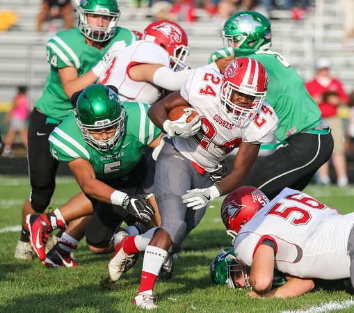 CHAD WEAVER | THE GOSHEN NEWS<br /> Goshen running back Jeff Stoll tries to break free from Concord linebacker Christian Arroyo during the first quarter of Friday night's game at Concord.