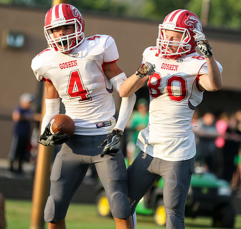 CHAD WEAVER | THE GOSHEN NEWS<br /> Goshen wide receivers Devan Love and Tayler Glasgow celebrate after Love caught a touchdown pass during the second quarter of Friday night's game at Concord.