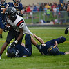 HALEY WARD | THE GOSHEN NEWS<br /> NorthWood wide receiver DeAndre Smart is brought down by Fairfield safties Brady Willard and Sylvanus Miller Friday at Fairfield Junior-Senior High School.