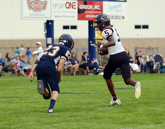 HALEY WARD | THE GOSHEN NEWS<br /> NorthWood DeAndre Smart runs past Fairfield safety Roger Burger to score Friday at Fairfield Junior-Senior High School.