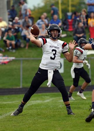 HALEY WARD | THE GOSHEN NEWS<br /> NorthWood quarterback Trey Bilinski passes during the game against Fairfield Friday at Fairfield Junior-Senior High School.