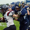 HALEY WARD | THE GOSHEN NEWS<br /> Fairfield safety Brady Willard tackles NorthWood running back Brayton Yoder Friday at Fairfield Junior-Senior High School.