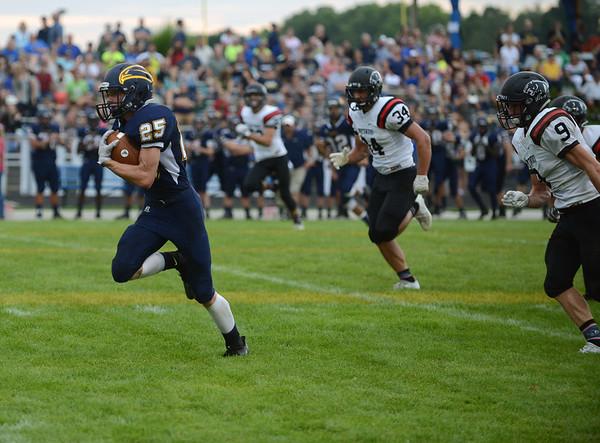 HALEY WARD | THE GOSHEN NEWS<br /> Fairfield running back Connor Kitson runs down field Friday at Fairfield Junior-Senior High School.
