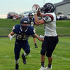 HALEY WARD | THE GOSHEN NEWS<br /> NorthWood wide receiver Bronson Yoder catches a pass while Fairfield safety Connor Kitson goes to tackle Friday at Fairfield Junior-Senior High School.