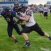 HALEY WARD | THE GOSHEN NEWS<br /> Fairfield safety Brady Willard goes to tackle NorthWood running back Brayton Yoder Friday at Fairfield Junior-Senior High School.