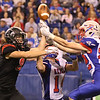 JAY YOUNG | THE GOSHEN NEWS <br /> Indianapolis Roncalli defenders Alex Kuntz (14) and Dylan Williams (22) work to break up a pass intended for NorthWood's Landen Gessinger (8) during the 4A state championship game Friday afternoon at Lucas Oil Stadium in Indianapolis.