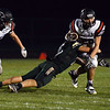 HALEY WARD | THE GOSHEN NEWS<br /> Wawasee linebacker Paul Mendoza tackles NorthWood running back Spencer Brubacher Friday at Wawasee High School.