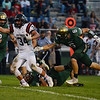 HALEY WARD | THE GOSHEN NEWS<br /> Wawasee defensive back Dylan Hepler-Fink (2), safety Rylan Kuhn (34) and safety Alec Rosbrugh (6) attempt to bring down running back Payton Bear Friday at wawasee High School.