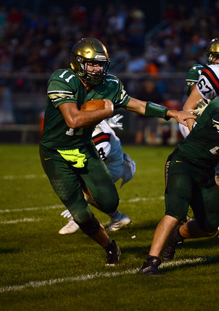 HALEY WARD | THE GOSHEN NEWS<br /> Wawasee quarterback Tyler Smith carries the ball against NorthWood Friday at Wawasee High School.