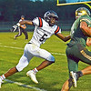 HALEY WARD | THE GOSHEN NEWS<br /> NorthWood defensive back DeAndre Smart goes to tackle Wawasee quarterback Tyler Smith Friday at Wawasee High School.