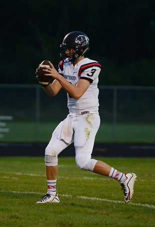HALEY WARD | THE GOSHEN NEWS<br /> NorthWood quarterback Trey Bilinski looks to pass the ball during the game against Wawasee Friday at Wawasee High School.