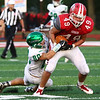JAY YOUNG | THE GOSHEN NEWS<br /> Goshen High School senior tight end Will Koshmider (49) tries to break free from Concord High School senior Kevin Sibal (80) after making a reception during their game Friday night at GHS.