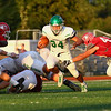 JAY YOUNG | THE GOSHEN NEWS<br /> Concord High School senior running back Dominick De Broka (34) makes Goshen High School senior defensive end Will Koshmider (49) miss during their game Friday night at GHS.