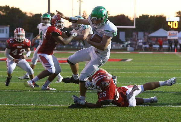 JAY YOUNG   THE GOSHEN NEWS<br /> Goshen High School senior defensive back Brandon Holley (25) saves a touchdown as he brings down Concord High School senior running back Jack Lietzan (14) down short of the goal line during their game Friday night at GHS.