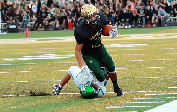 STACEY DIAMOND   THE GOSHEN NEWS<br /> Concord's Kevin Sibal (80) drags down Wawasee's Dylan Hepler Fink (2).