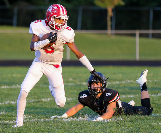 CHAD WEAVER | THE GOSHEN NEWS<br /> Goshen wide receiver Daveyon Sanford looks upfield after breaking away from NorthWood linebacker Jake Chupp on a kickoff return during the second quarter of Friday night's game at NorthWood.