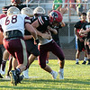 Stacey Diamond | The Goshen News<br /> Northwood's Ethan Hochestetler, 42, gives a little push from behind, to help Landen Gessinger, 8, as Jimtown's defense, including Alex Reaves, 68, tries to halt Gessinger