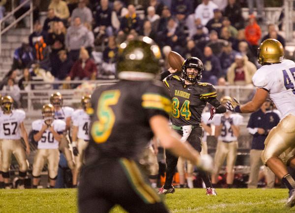 SAM HOUSEHOLDER   THE GOSHEN NEWS<br /> Northridge senior quarterback Payton Carson passes to senior receiver Cody Miller Friday during the sectional game against Bishop Dwenger.