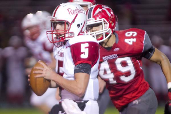 SAM HOUSEHOLDER | THE GOSHEN NEWS<br /> Goshen junior Jordan Holley pursues Plymouth quarterback junior Jack Barron during the game Friday.