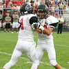 CHAD WEAVER | THE GOSHEN NEWS<br /> NorthWood DB's Travis Bear and Josh Chupp celebrate after making a stop during the 1st quarter of Friday's game at Jimtown.