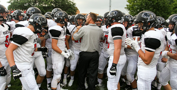 CHAD WEAVER | THE GOSHEN NEWS<br /> NorthWood head coach Nate Andrews talks with his team before they take the field prior to Friday night's game at Jimtown.