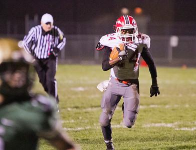 SAM HOUSEHOLDER | THE GOSHEN NEWS Goshen sophomore running back Jeff Stoll runs with the ball against Wawasee Friday.