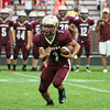 CHAD WEAVER | THE GOSHEN NEWS<br /> Jimtown sophomore Mason Castro looks for an opening after taking a handoff during the 1st quarter of Friday night's game against NorthWood at Jimtown.