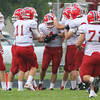 CHAD WEAVER | THE GOSHEN NEWS<br /> Goshen teammates surround RB Cam Kline (4) after Kline broke free for a 72-yard touchdown run during the second quarter of Friday night's game at Elkhart Central.