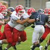 CHAD WEAVER | THE GOSHEN NEWS<br /> Goshen defenders #47, #49, #35, and #90 surround Elkhart Central RB Joe Phillips during the first quarter of Friday night's game at Central.