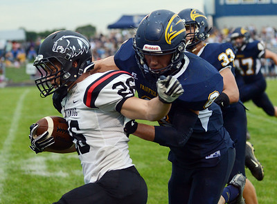 HALEY WARD | THE GOSHEN NEWS Fairfield safety Brady Willard tackles NorthWood running back Brayton Yoder Friday at Fairfield Junior-Senior High School.