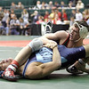 Justin Slaughterbeck of Oak Harbor works back points on Mike Triscaro of Chagrin Falls Kenston in the championship quarterfinals on Friday.  Slaughterbeck won 10 - 2.<br /> Photo Ben French