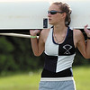 Allison Sobiech of the Westerville Women's varsity eight team holds up their boat prior to their preliminary race in the Ohio Governor's Cup Regatta on Saturday at Griggs Reservoir.