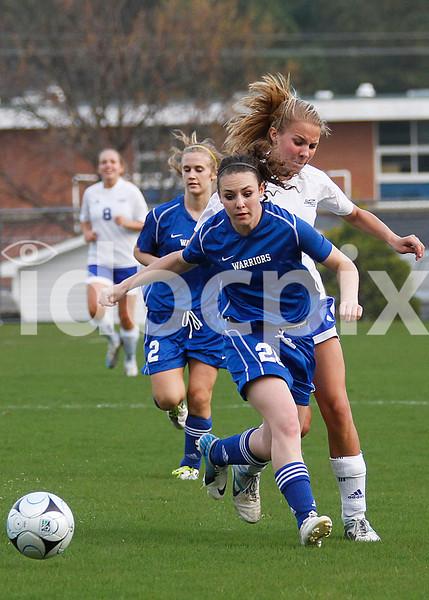 East Wake defender McKenzie Gairrett (20) shields Clayton forward Claudia Woznichak (9) from the ball.