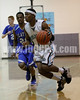 West's Darius Williams drives to the basket as Clayton's Rodney Moore (20) defends the play. Clayton won the Greater Neuse River Conference game 53-42 held at West Johnston High on February 7, 2012.  Photo by Dean Strickland OD.