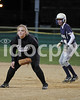 Clayton 1B Abby Durham (12)  and SSS base runner Lauren Batten (8) watch the pitch. Clayton won the Greater Neuse River conference game 14-1 over SSS played in Smithfield on Tuesday night.
