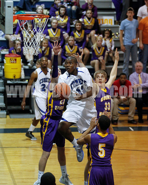 Gary Clark goes up between CHHS's Kenny Collins, Ethan Kersat and Kahlil Larry tried to defend.Photo by Dean Strickland OD.