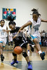 West's Jarmelia Holder (30) tries to challenge Clayton's  Latesha Williams (12) for a loose ball. The Clayton girls won the Greater Neuse River Conference game 74-43 held at West Johnston High School on February 7, 2012. Photo by Dean Strickland OD.