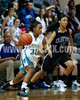 West's Jarmelia Holder (30) drives around Clayton's Amber Caudle (5). The Clayton girls won the Greater Neuse River Conference game 74-43 held at West Johnston High School on February 7, 2012. Photo by Dean Strickland OD.