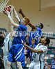 Clayton's Kyle Bryant (22) and Adonis Banks (24) go up to wrestle the rebound away from Blair Pietrowski (32). Clayton won the Greater Neuse River Conference game 53-42 held at West Johnston High on February 7, 2012.  Photo by Dean Strickland OD.