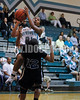 West Johnston's Shorty Frederick  (21) goes for the lay-up and is fouled by Clayton's Latesha Williams (12). The Clayton girls won the Greater Neuse River Conference game 74-43 held at West Johnston High School on February 7, 2012. Photo by Dean Strickland OD.