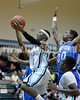 West's Darius Williams (11) drives to the basket as Clayton's Rodney Moore (20) tries to make the stop. Clayton won the Greater Neuse River Conference game 53-42 held at West Johnston High on February 7, 2012.  Photo by Dean Strickland OD.