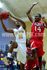 Ki-yon Walden (10) goes to the hoop as Franklinton's Jamal Johnson (14) for the basket.