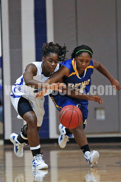 Clayton's Tajah Clark (4) and East Wake's D. Thorpe (24) battle for a loose ball.