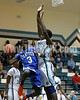 Clayton's Anthony Gaskins (3) tries to get around West's Pablo Guerrero (43) as he cuts off the basket. Clayton won the Greater Neuse River Conference game 53-42 held at West Johnston High on February 7, 2012.  Photo by Dean Strickland OD.