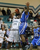 West Johnston's Ernest Harrington (34) goes up for a shot as Clayton's Adonis Banks (24) goes for the block. Clayton won the Greater Neuse River Conference game 53-42 held at West Johnston High on February 7, 2012.  Photo by Dean Strickland OD.