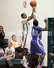 West's Montrell Brooks gets off a shot over Clayton's Anthony Gaskins (3) at the start of the 2nd half. Clayton won the Greater Neuse River Conference game 53-42 held at West Johnston High on February 7, 2012.  Photo by Dean Strickland OD.