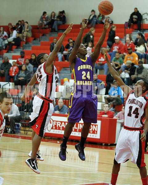 Klilah Cox (24) gets a shot off as Red Rams' Tyquon Crudup (25) and Jamal Johnson (14) defend