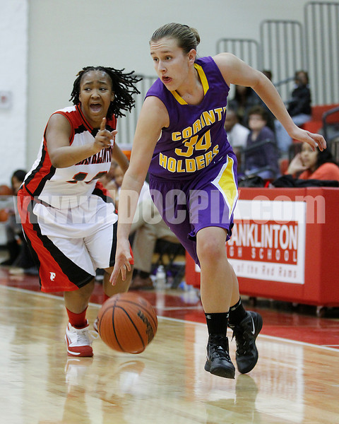 Pirate Holly Price (34) heads to the basket as Lady Ram Diesha Davis (10) shouts to her teammates to pick up coverage.
