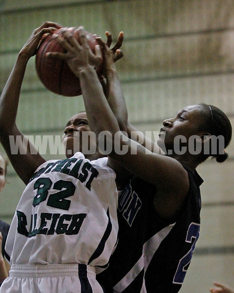Clayton's Jasmine Dixon (23) battles Southeast Raleigh's Tiffany McCarter (32) for a rebound. Southeast Raleigh won the Greater Neuse River Conference game held at Southeast Raleigh High School 31-28. Photo by Dean Strickland OD.